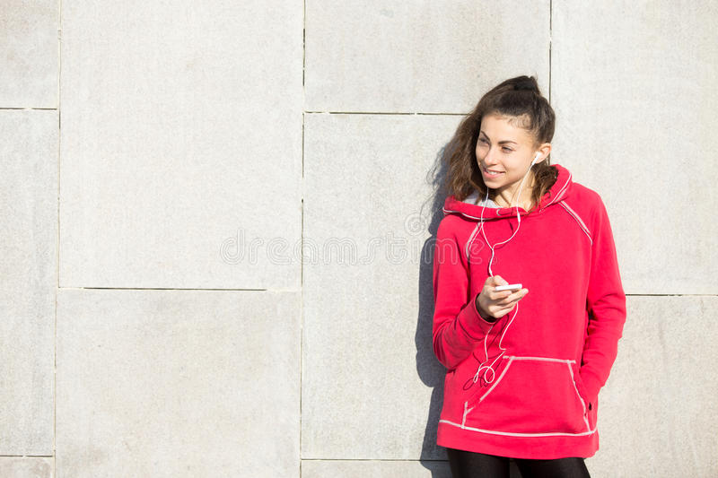 Woman athlete runner holding smartphone royalty free stock photo