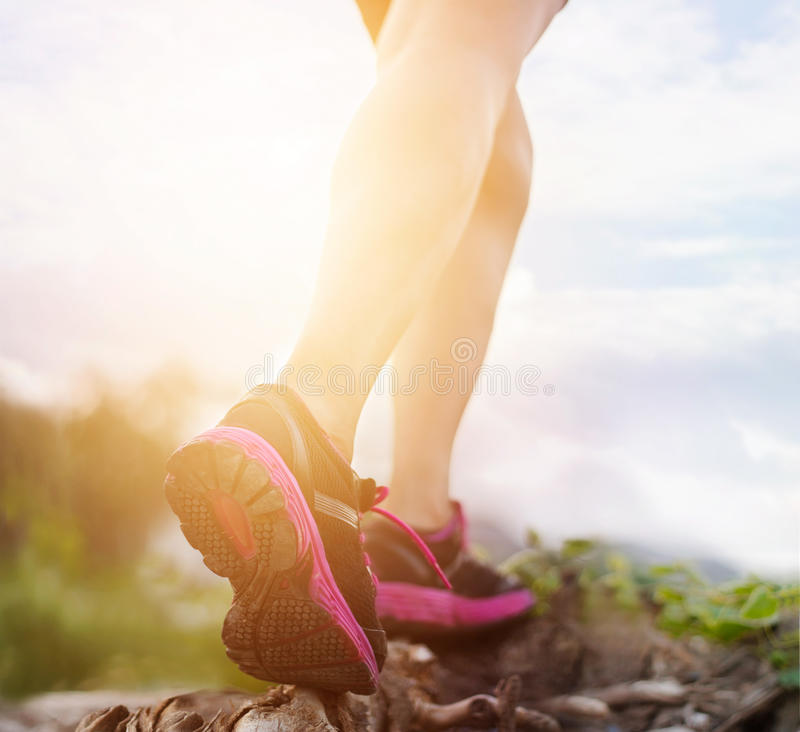 Woman athlete running on nature for healthy royalty free stock images