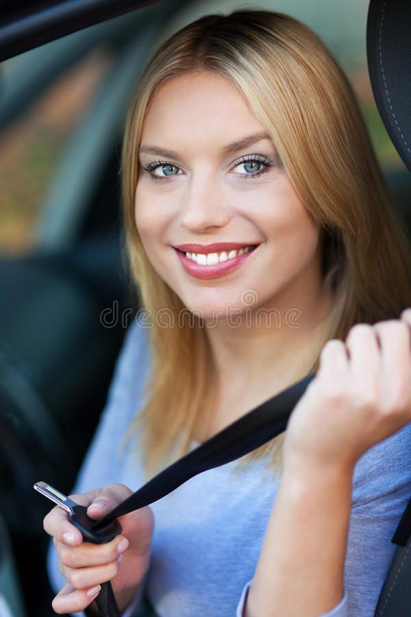 Download Woman Attaching Seat Belt In Car Stock Photo - Image: 27663890