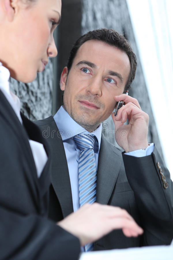Woman attracted by her boss stock photography