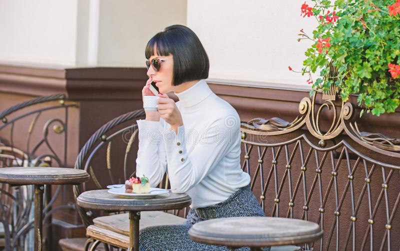 Woman attractive elegant brunette spend leisure cafe terrace background. Pleasant time and leisure. Relax and coffee royalty free stock photography