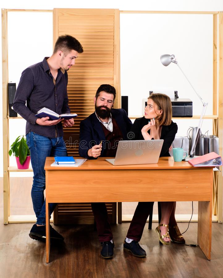Woman attractive lady working with men colleagues. Office collective concept. Coworkers communicate solving business stock photography