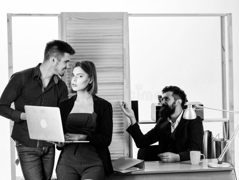 Woman attractive lady working with men. Office collective concept. Sexual attraction. Stimulate sexual desire royalty free stock photography
