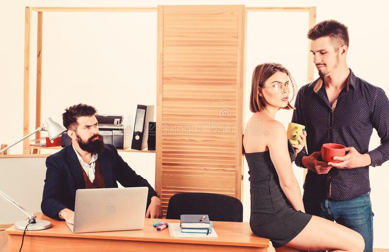 Woman attractive working man colleague. Office romance concept. Sexual attraction among certain coworkers. Flirting and royalty free stock image