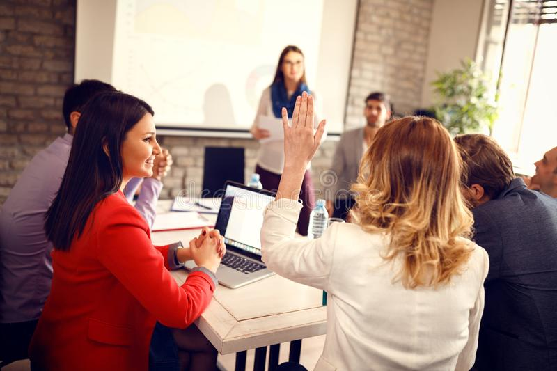 Woman from audience wants to talk. Woman from audience on business meeting wants to talk royalty free stock photography