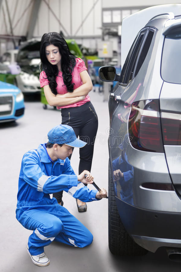 Woman in Auto Repair Shop royalty free stock image