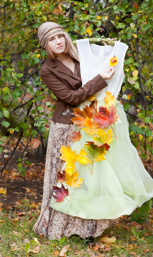 Download Woman with autumn dress stock photo. Image of outdoors - 27075414