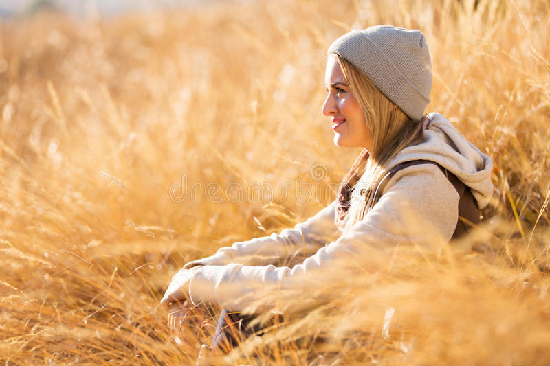 Woman autumn grass stock photography