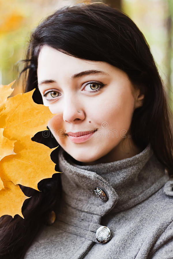 Woman with autumn leaf royalty free stock image
