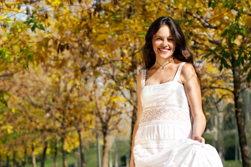 Woman in the autumn park. Beautiful woman in the autumn park stock photo