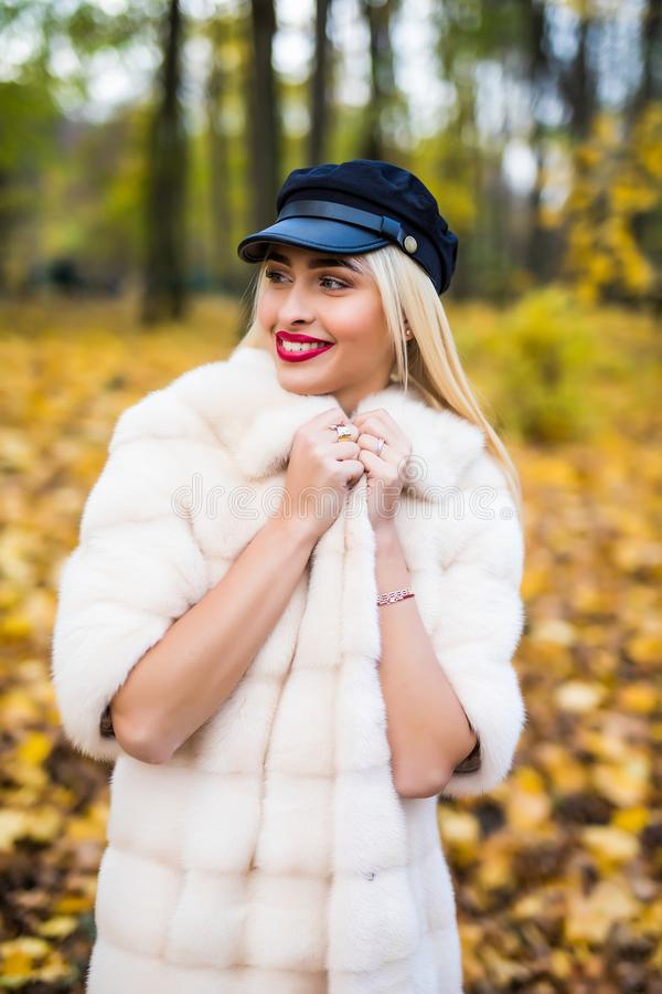 Woman autumn portrait. Fashion girl outdoor. Autumn woman having fun at the park and smiling. young woman portrait in autumn color stock images