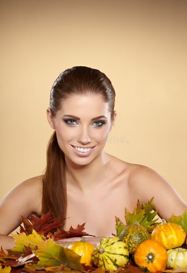 Woman with autumn pumpkin stock photo