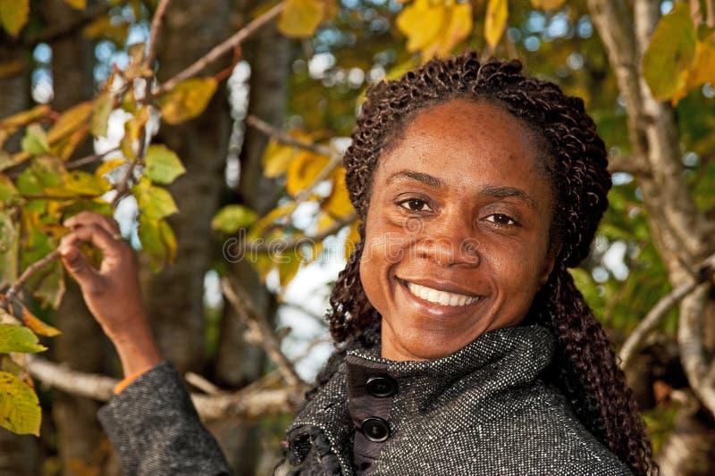 Download Woman among Autumn trees stock image. Image of coat, model - 27324773