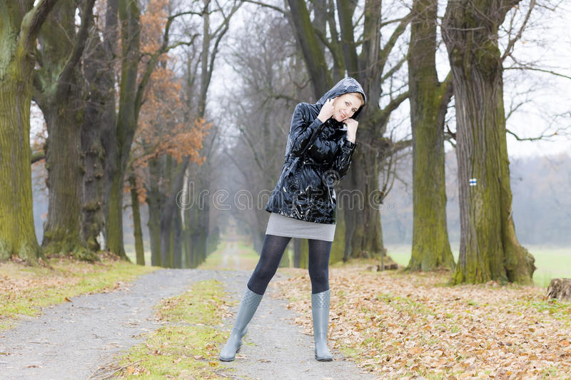 Download Woman in autumnal alley stock photo. Image of fashion - 26732912