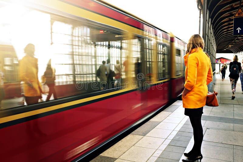 Woman awaiting commuter train in Berlin stock photos