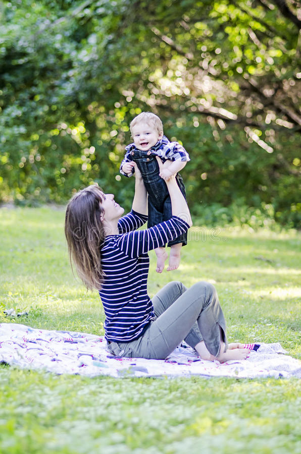 Woman and baby at the park royalty free stock photo