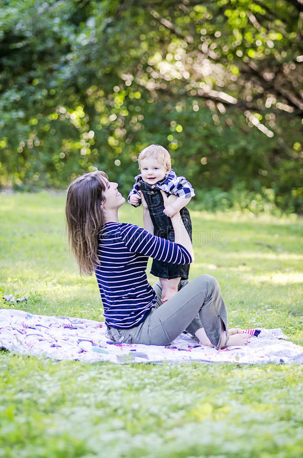 Woman and baby at the park royalty free stock photos