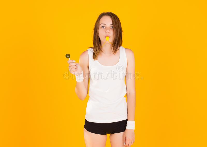 Young cute girl with whistle, studio stock images
