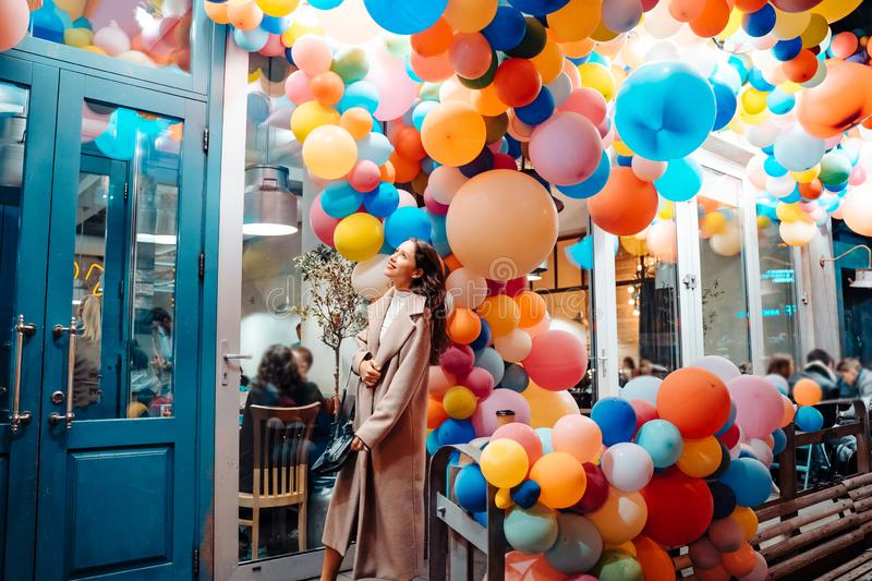 Woman on the background of wooden door with balloons stock photo