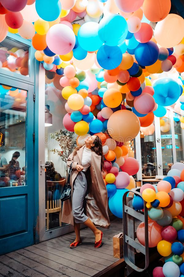 Woman on the background of wooden door with balloons stock image