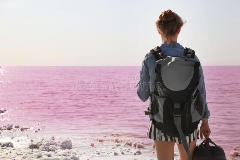 Woman with backpack on coast royalty free stock photos