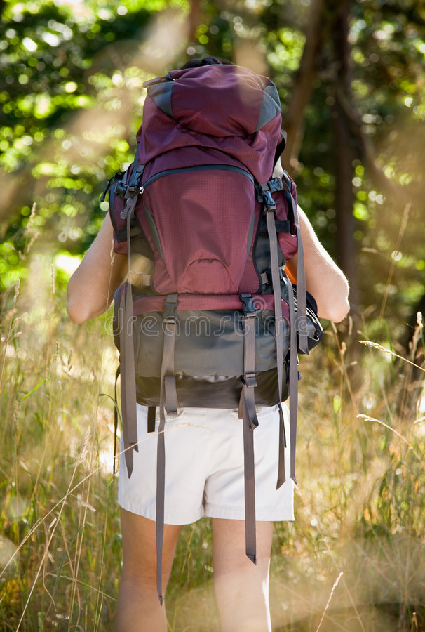 Woman with backpack hiking stock photos