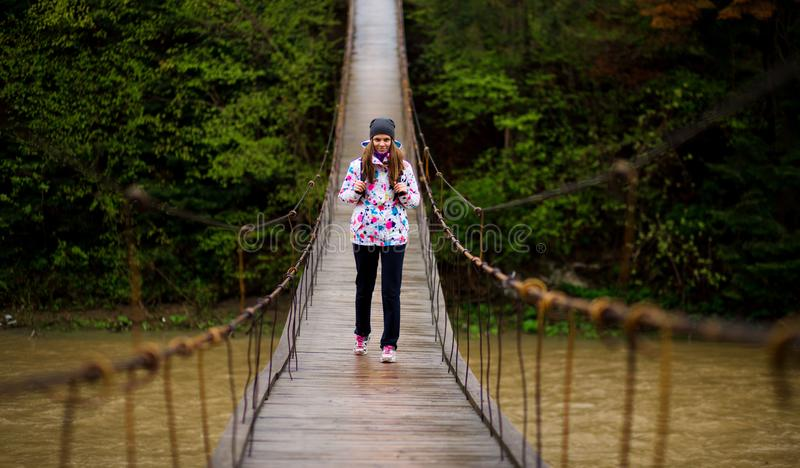 Woman with backpack hiking Lifestyle adventure concept forest and cross river in forest royalty free stock photo
