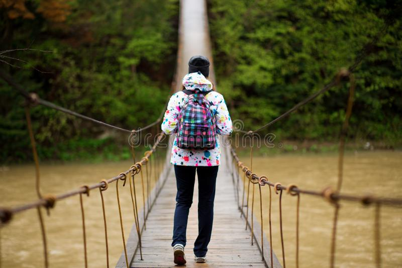 Woman with backpack hiking Lifestyle adventure concept forest and cross river in forest active vacations stock images