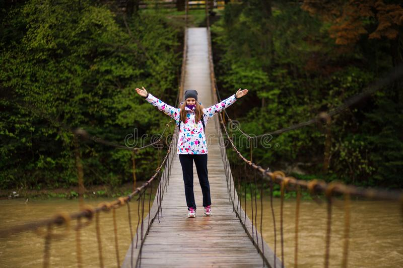 Woman with backpack hiking Lifestyle adventure concept forest and cross river in forest royalty free stock image