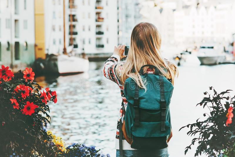Woman with backpack walking in Alesund city stock photos