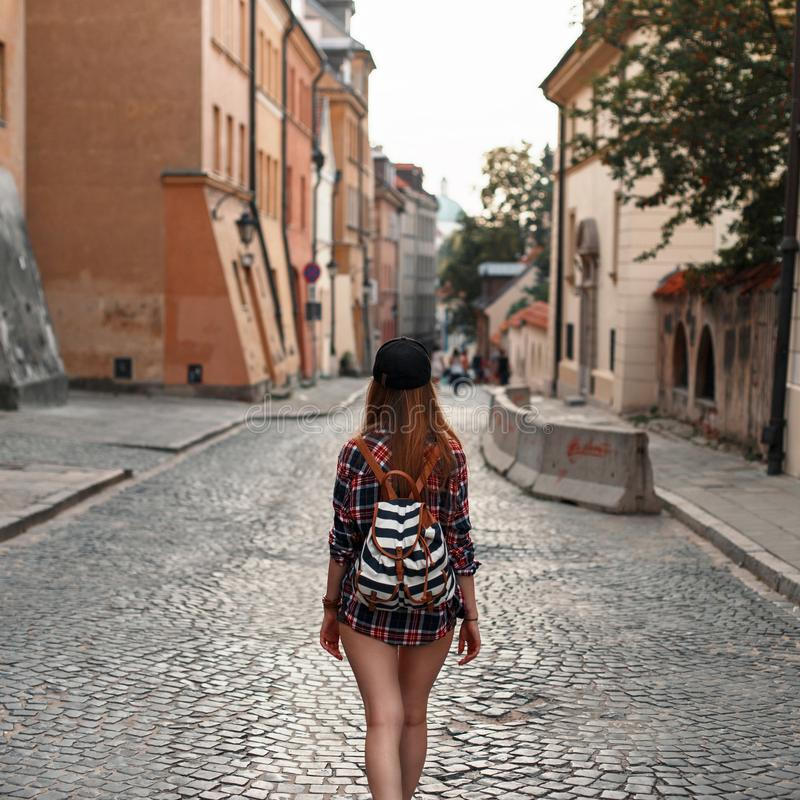 Woman with a backpack walking around the city. Euro-trip. stock photo