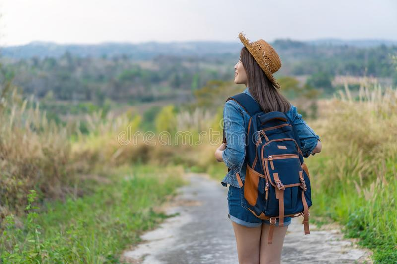 Woman with backpack walking on footpath in nature royalty free stock photos