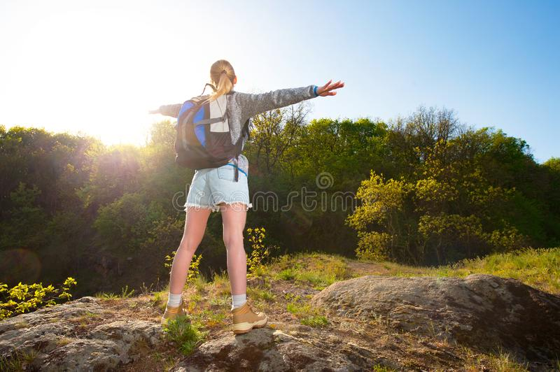 Woman backpacker enjoy the view in forest on the path during sum stock photo