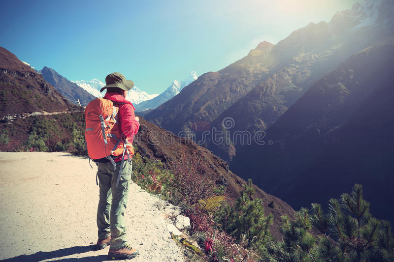 Woman backpacker enjoy the view on himalaya mountains royalty free stock photo