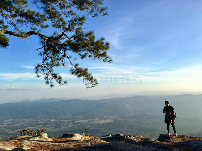 Woman backpacker standing on the mountain top stock photos