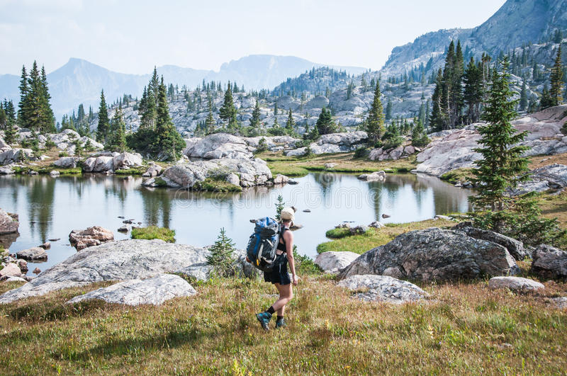 Woman Backpacking. A young woman backpacking in the Colorado tundra stock photos