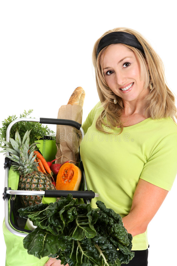Woman bag full of groceries. Fresh Healthy Produce. A woman holds a basket full of fresh food items stock image