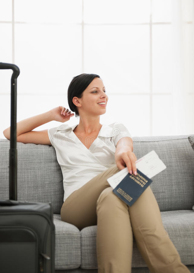 Woman with bag holding passport and ticket royalty free stock images