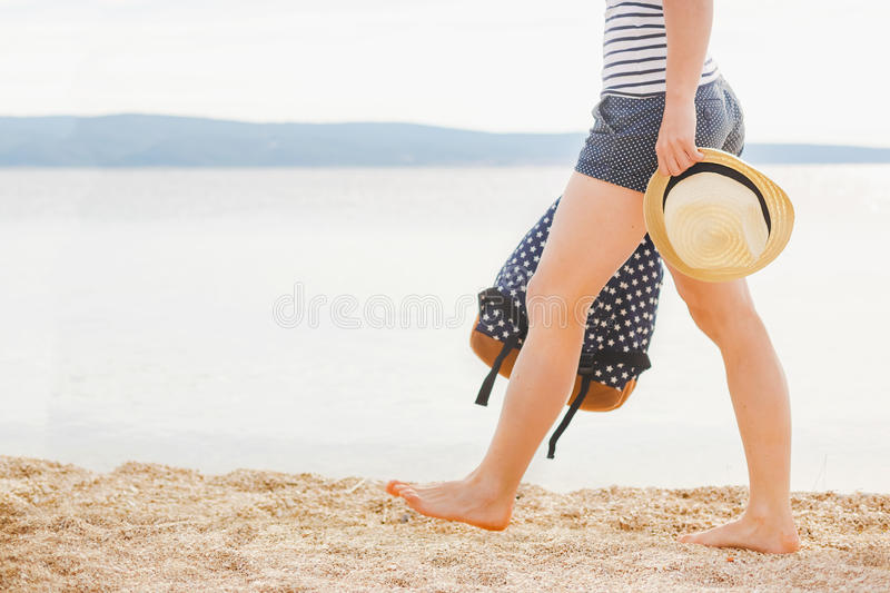 Woman with bag and sun hat going on the beach. Sea time. Freedom concept royalty free stock images
