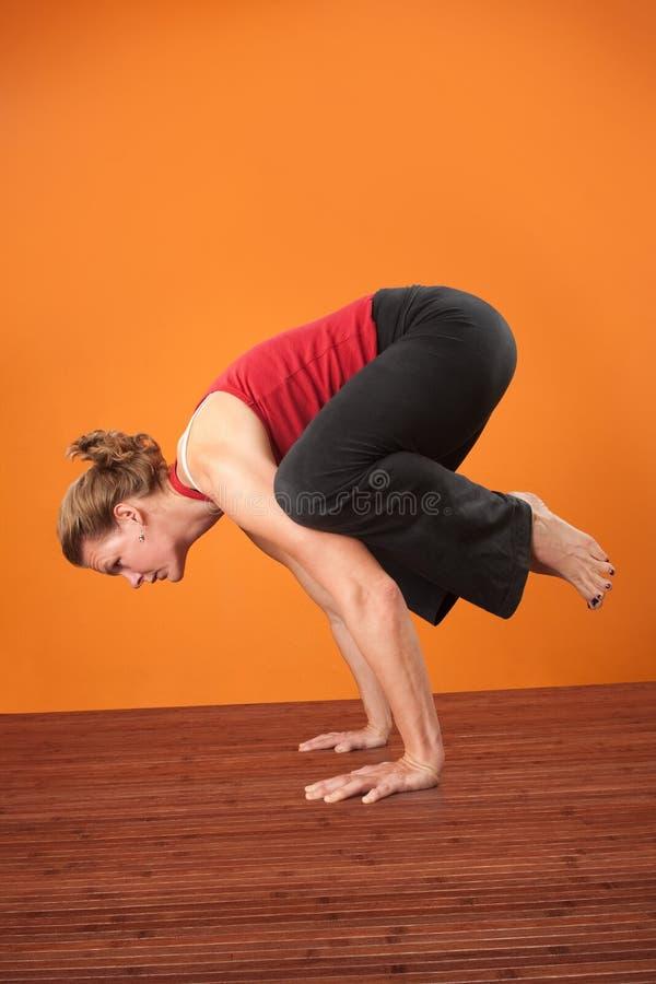 Download Woman in Bakasana Posture stock photo. Image of power - 23221142