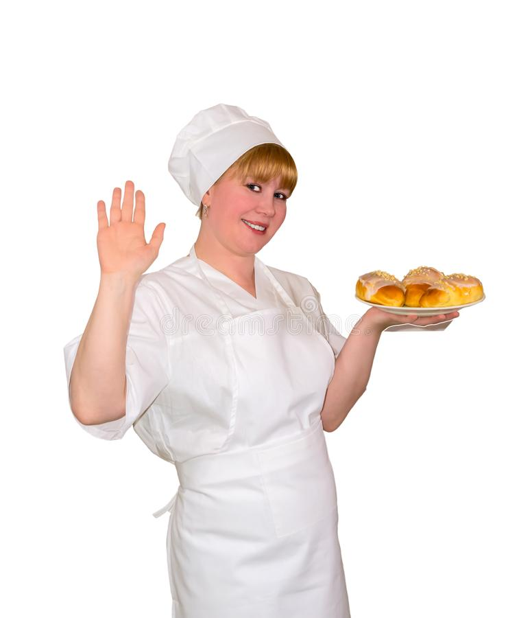 Woman baker holds a dish with sweet buns isolated royalty free stock photo