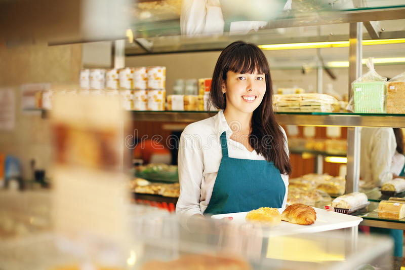 Woman in bakery stock photos