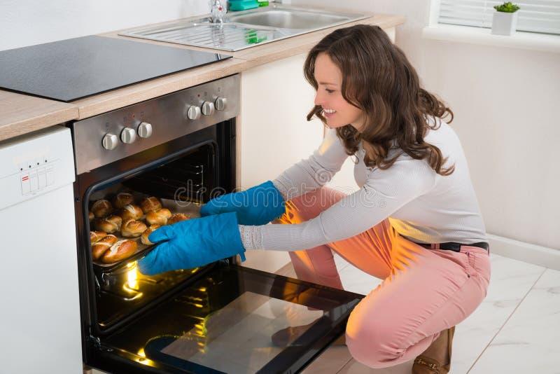 Woman Baking Bread Roll royalty free stock photos