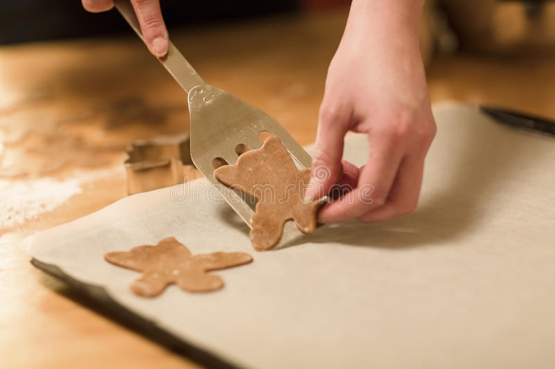Woman Makes Gingerbread Angels stock images