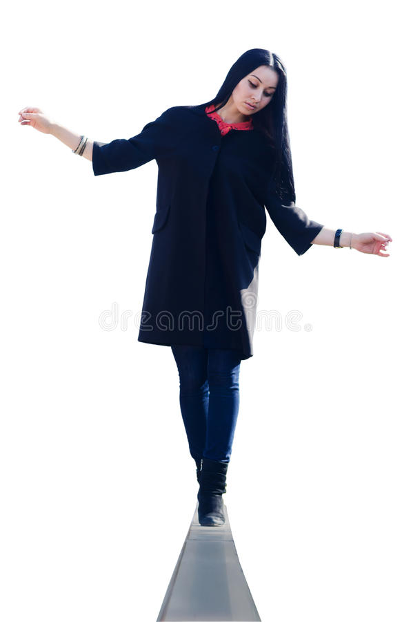 A woman is balancing on the edge royalty free stock image