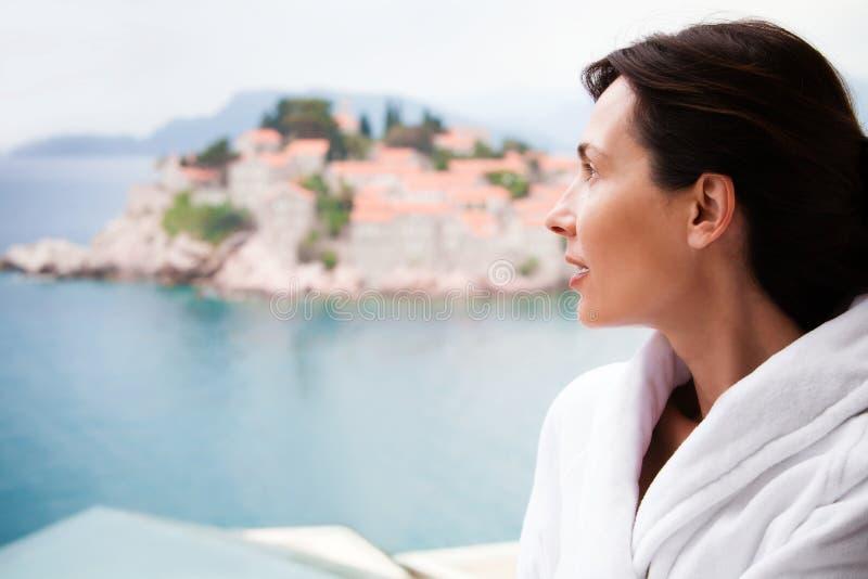 Woman at balcony royalty free stock photography