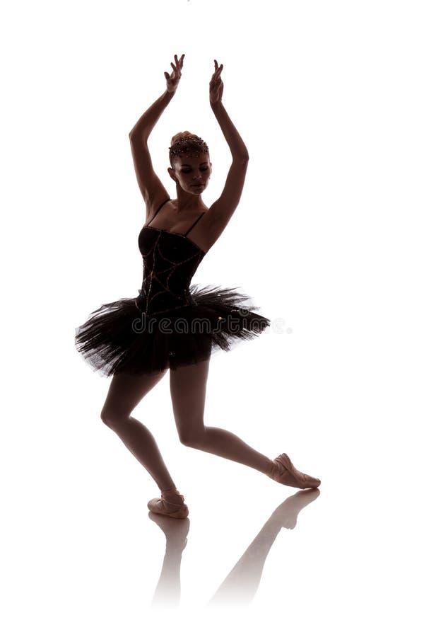 Woman ballerina in black pack tutu posing on white background stock images