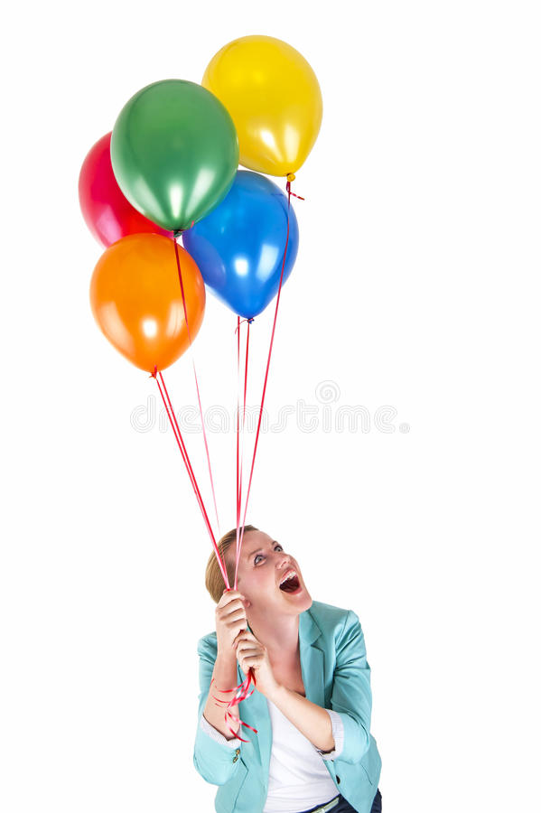 Woman with balloons over white background smiling. Fun stock photography