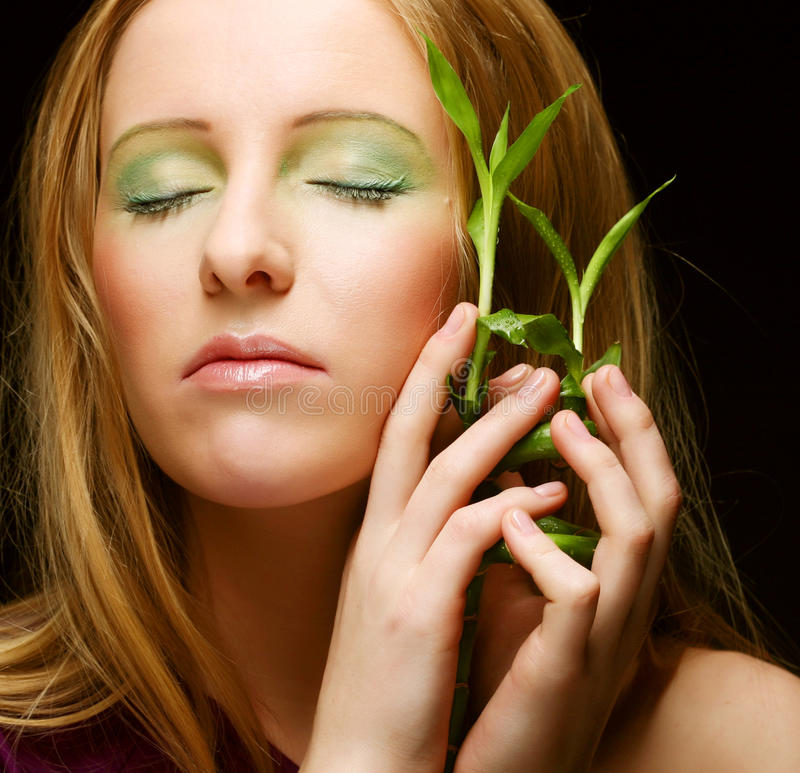 Woman with bamboo. On black background royalty free stock images