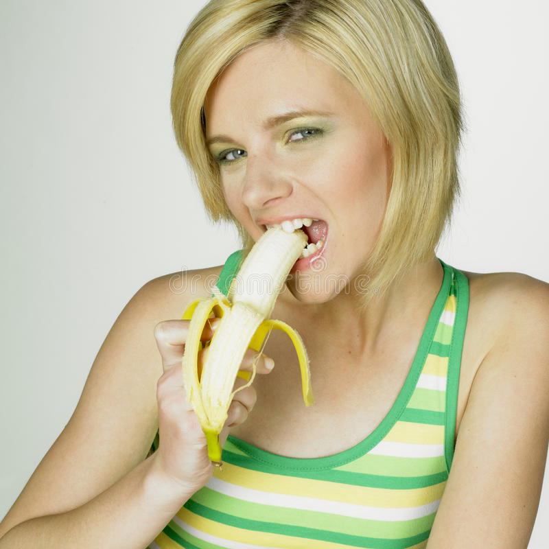 Woman with banana royalty free stock photography